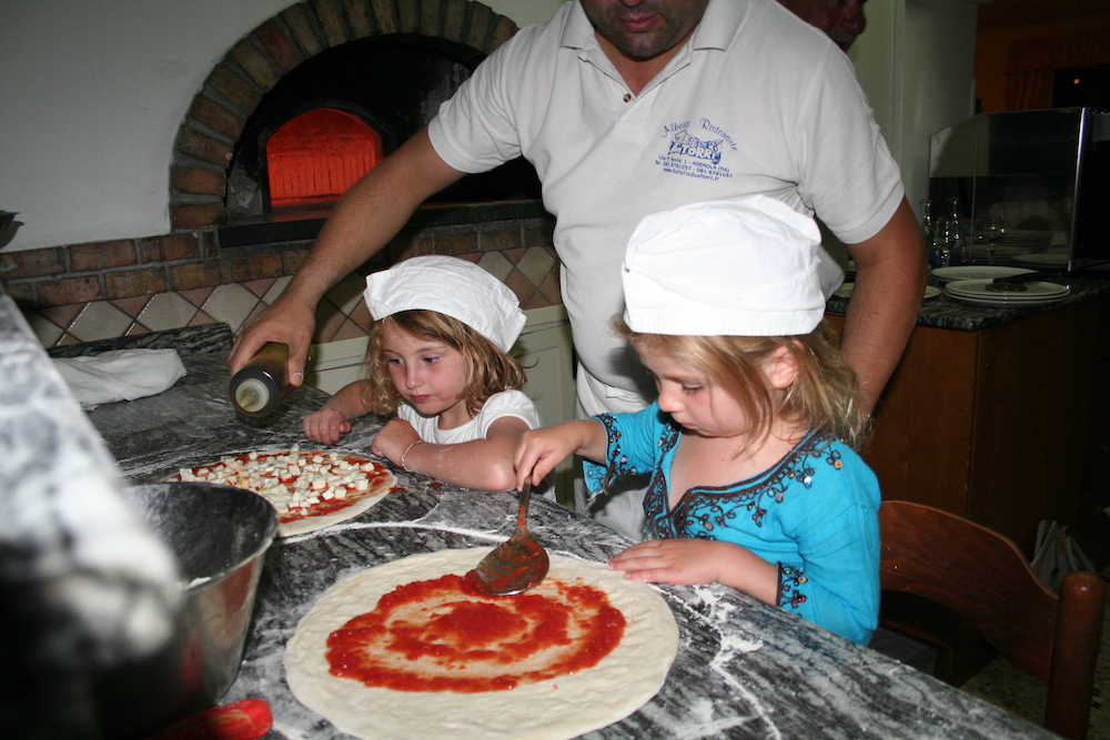 Children making pizza in Italy