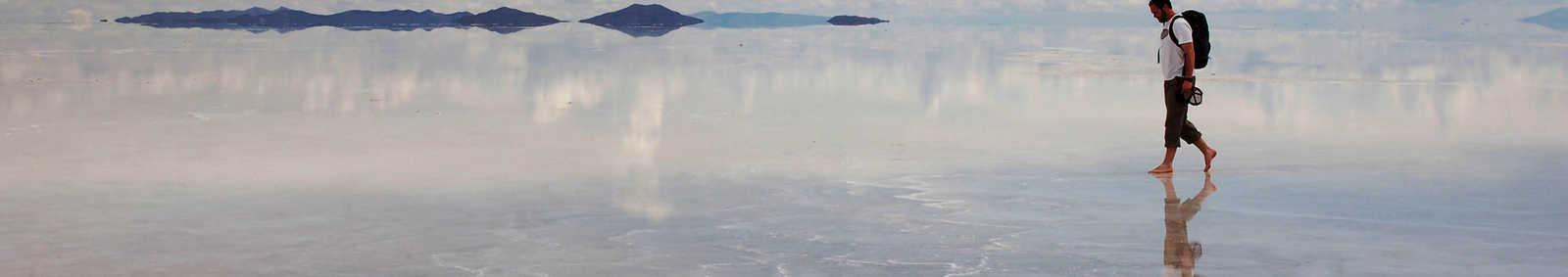 Walking over the reflective surface of the Uyuni Salt Flats, Bolivia
