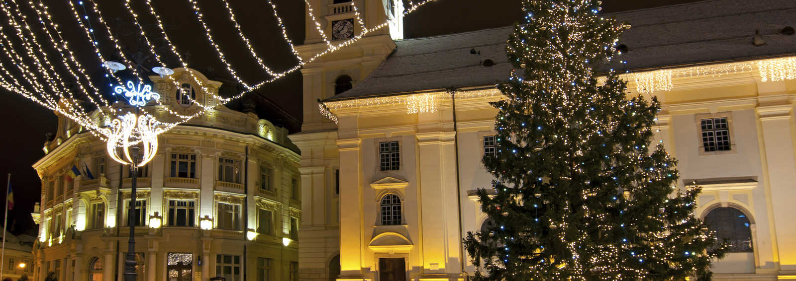Christmas tree and lights in old town square, Romania