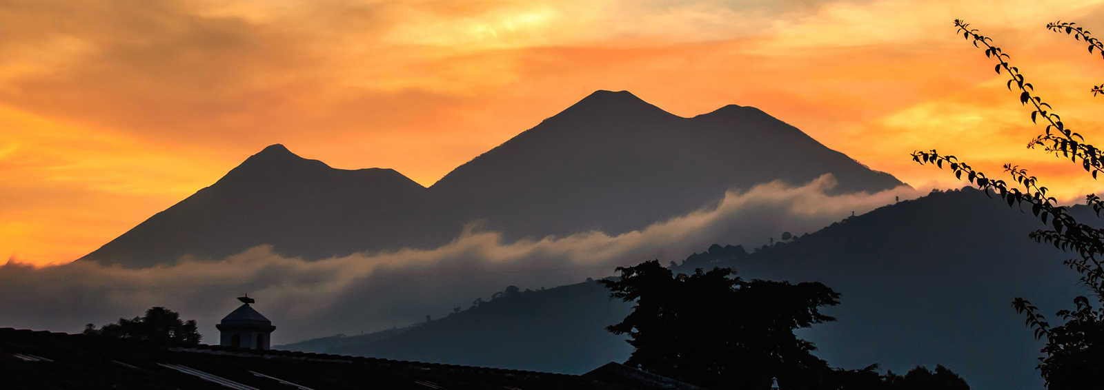 Fuego & Acatenango volcanoes at sunset, near Antigua, Guatemala