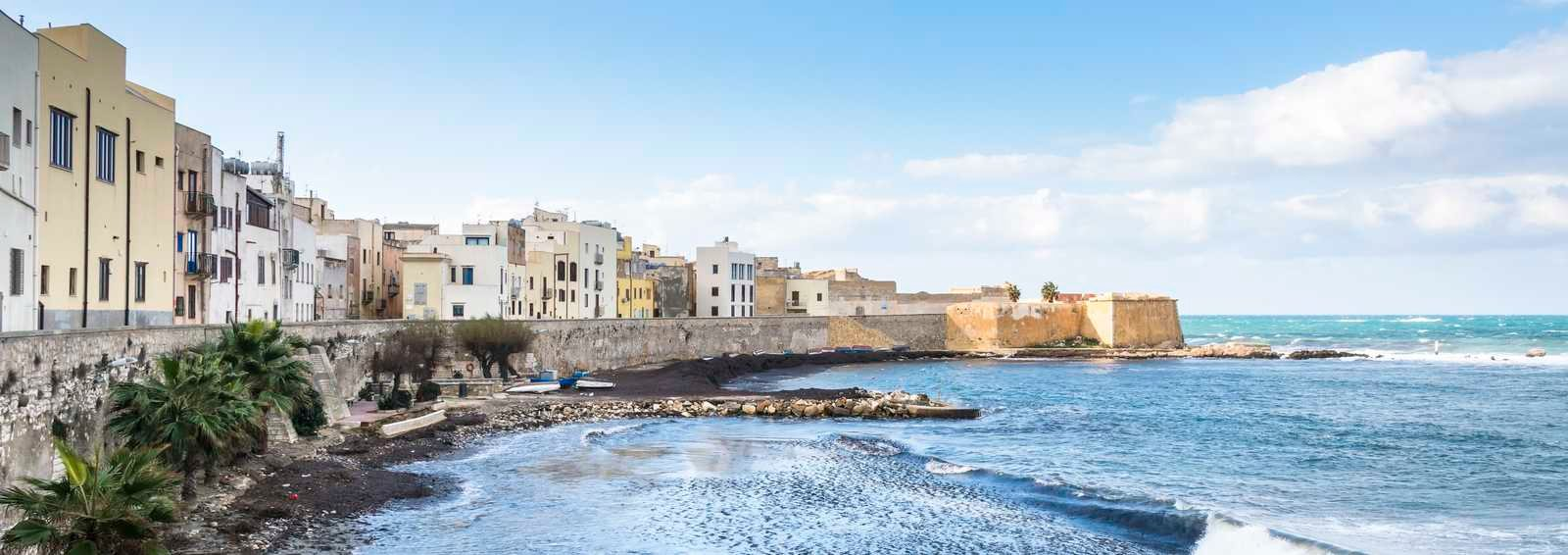 Panoramic view of the Trapani harbor with fisherman boats, Sicily, Italy.