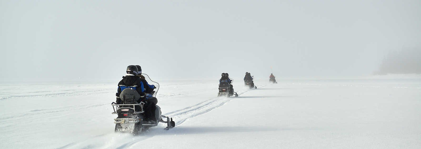 Snowmobiling from Pine Bay Lodge