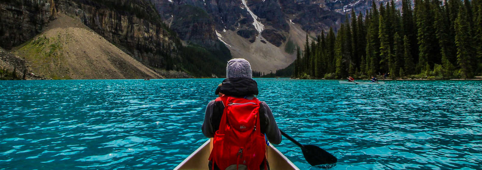 Canoeing on the incredible turquoise water of Moraine Lake, in Banff National Park.