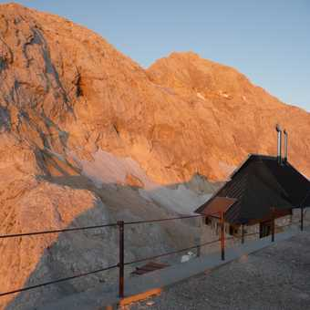 Day 5 - Early morning sunshine lights up the east face of Triglav