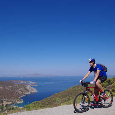 Cyclist on a Greece coastal road