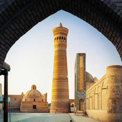 Yard of Poi Kalyan oriental complex at sunset. View from the gate. Bukhara