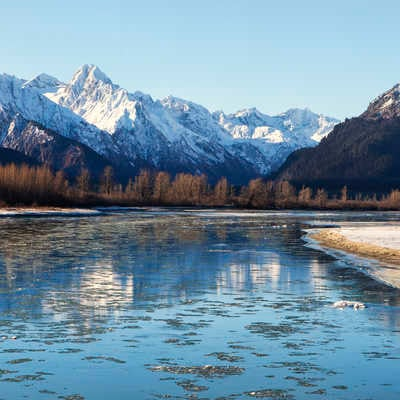 Ice floating in the Chilkat River near Haines Alaska on a sunny November day.