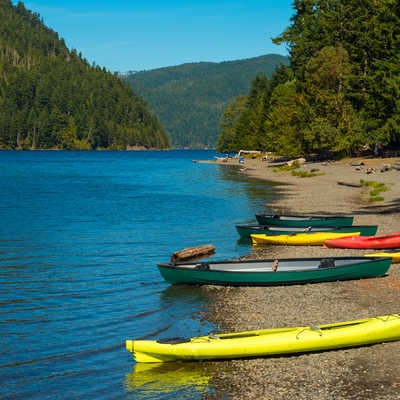 Canoes and kayaks on the beach at Crescent Lake on Washington's Olympic Peninsula