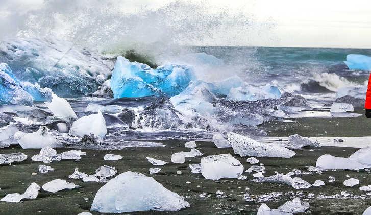 Waves crash against icebergs at Jokulsarlon glacial lagoon near Vatnajokull National Park