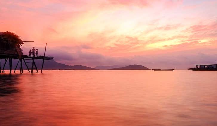Beautiful sunrise at Maiga Sipadan island with seagypsy house located at Semporna, Sabah, Malaysia